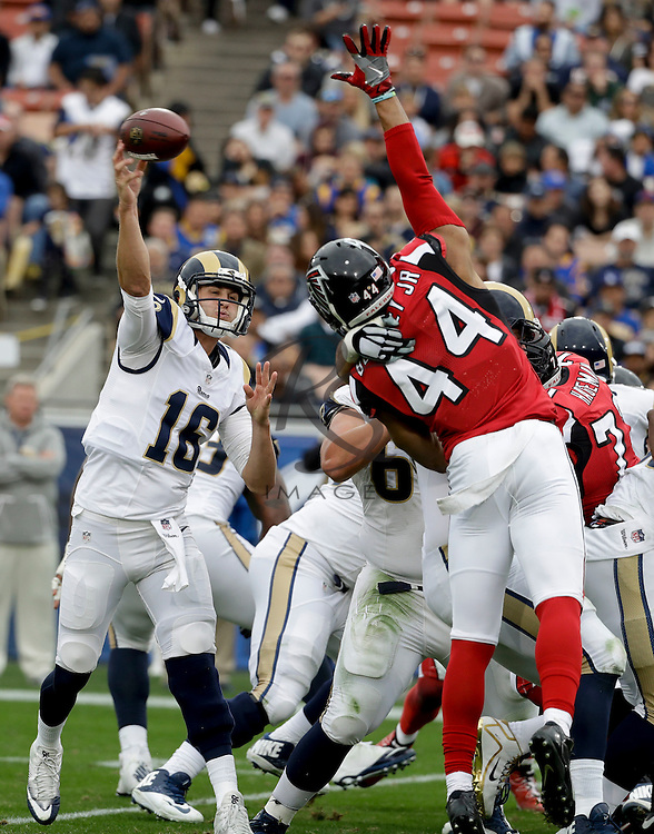 Los Angeles Rams quarterback Jared Goff throws an interception for a Atlanta Falcons touchdown during the first half of an NFL football game Sunday, Dec. 11, 2016, in Los Angeles. (AP Photo/Rick Scuteri)