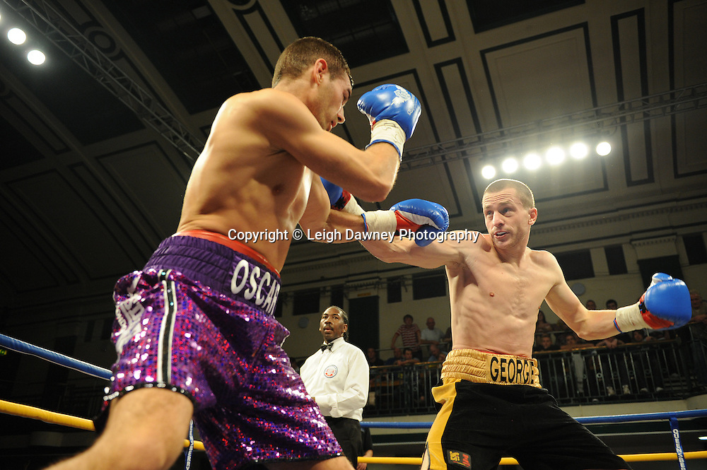 Steve O'Meara (purple shorts) defeats Ryan Toms for The Southern Area Light-Middleweight Championship at York Hall, Bethnal Green, London on Friday 30th September 2011. Box Nation.tv's debut live TV Channel 456 on Sky. Photo credit: © Leigh Dawney. Queensberry Promotions.