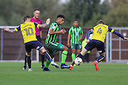 Oxford United striker Chris Maguire (10) and Oxford United midfielder John Lundstram (captain) close down AFC Wimbledon striker Lyle Taylor (33) during the EFL Sky Bet League 1 match between Oxford United and AFC Wimbledon at the Kassam Stadium, Oxford, England on 9 October 2016. Photo by Stuart Butcher.