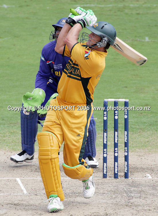 Australian opening batsman Adam Gilchrist hits another 6 during his record breaking 149 at the 2007 ICC Cricket World Cup Final between Australia and Sri Lanka at Kensington Oval, Barbados, West Indies on Saturday 28 April 2007. Australia won the toss and elected to bat first and scored 281/4 off 38 overs. Photo: Andrew Cornaga/PHOTOSPORT<br /><br /><br />280407