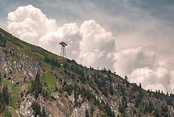THEMENBILD - imposant steht eine Stütze der neuen K-onnection (3K Verbindungsbahn von Kaprun, Maiskogel auf das Kitzsteinhorn) auf einem Berghang Die 3K Bahn wird im Dezember 2019 eröffnet. Dahinter türmen sich Wolken auf, aufgenommen am 01. Juli 2019, Kaprun, Österreich // The new K-onnection (3K connecting railway from Kaprun, Maiskogel to the Kitzsteinhorn) on a mountain slope is impressively supported. The 3K railway will be opened in December 2019. Clouds pile up behind it on 2019/07/01, Kaprun, Austria. EXPA Pictures © 2019, PhotoCredit: EXPA/ Stefanie Oberhauser