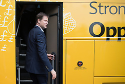 © Licensed to London News Pictures . 01/05/2015 . Manchester , UK . Nick Clegg leaves on the Liberal Democrat battle bus , after a Liberal Democrat party rally at Chorlton-cum-Hardy Golf Club . Liberal Democrat party leader Nick Clegg visits the constituency of Manchester Withington to deliver a speech on the NHS and campaign with local candidate John Leech . Photo credit : Joel Goodman/LNP
