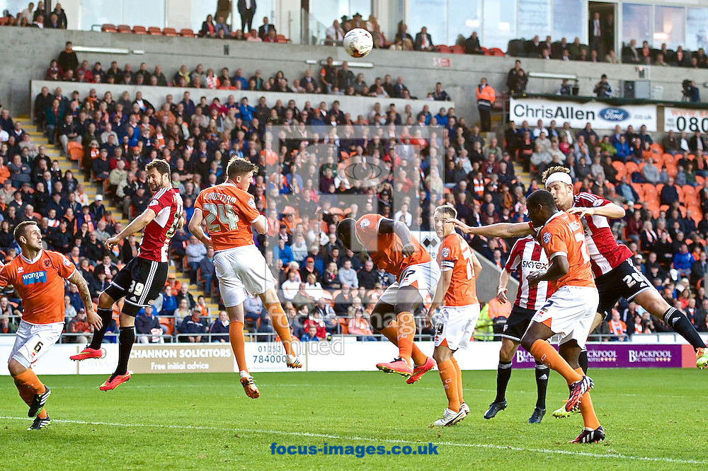 John Lundstram of Blackpool heads clear during the Sky Bet Championship match at Bloomfield Road, Blackpool<br /> Picture by Ian Wadkins/Focus Images Ltd +44 7877 568959<br /> 19/08/2014