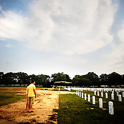 "Colin and Dana Kelly, (both of Austin, TX) visit Section 60 at Arlington National Cemetery in Arlington, VA on Saturday, July 25, 2009.  Mr. Kelly served as an Infantry officer in the 1st Battalion, 506th Regiment, ""B"" Company in Iraq in 2004 and 2005 and visits a fallen comrade once a year."
