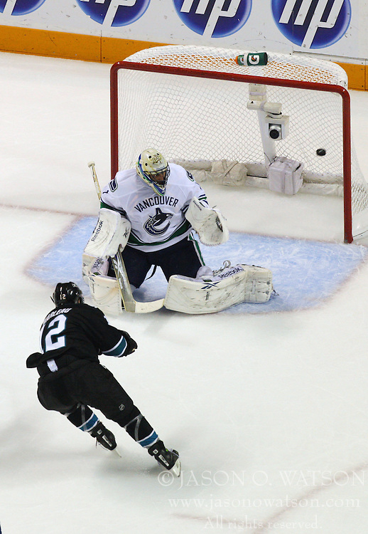 May 20, 2011; San Jose, CA, USA; San Jose Sharks center Patrick Marleau (12) scores a goal past Vancouver Canucks goalie Roberto Luongo (top) during the first period of game three of the western conference finals of the 2011 Stanley Cup playoffs at HP Pavilion. Mandatory Credit: Jason O. Watson / US PRESSWIRE