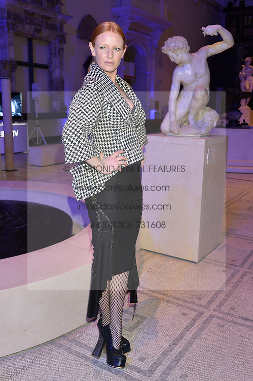 OLIVIA INGE at a private view of Alexander McQueen's Savage Beauty exhibition hosted by Samsung BlueHouse at the V&A, London on 30th March 2015.