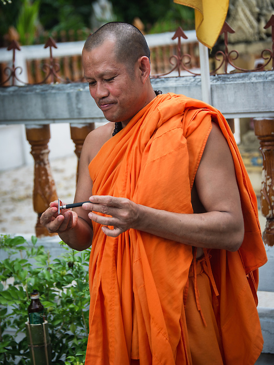 A Monk prepares to shave the heads of young men so they can become novice monks in  rural Nakhon Nayok, Thailand.