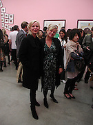 Amanda Elliasch and Kay Saatchi. JAKE AND DINOS CHAPMAN'S ' Like a dog returns to its vomit' White Cube, Hoxton Sq and afterwards at Vic Naylor's. St. John St. London.   18 October 2005. ONE TIME USE ONLY - DO NOT ARCHIVE © Copyright Photograph by Dafydd Jones 66 Stockwell Park Rd. London SW9 0DA Tel 020 7733 0108 www.dafjones.com