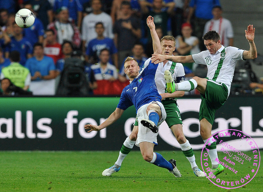 Poznan 18/06/2012.POLAND, Poznan.Ignazio Abate of Italy fights for the ball with Robbie Keane and Damien Duff of Ireland during the Euro 2012 football championships match Italy vs Ireland on June 18, 2012 during the Euro 2012 football championships .Photo by: Piotr Hawalej / WROFOTO