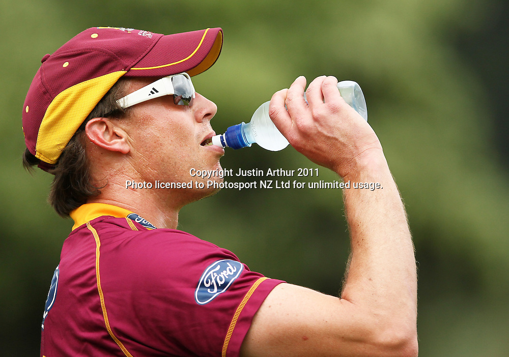 Graeme Aldridge has a drink of water. Ford Trophy - Wellington Firebirds v Northern Knights, Hawkins Basin Reserve, Wellington, New Zealand on Wednesday 14 December2011. Photo: Justin Arthur / Photosport.co.nz