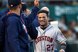 OAKLAND, CA - JULY 19:  Jose Altuve #27 of the Houston Astros is congratulated by teammates after scoring a run against the Oakland Athletics during the third inning at the Oakland Coliseum on July 19, 2016 in Oakland, California. (Photo by Jason O. Watson/Getty Images) *** Local Caption *** Jose Altuve