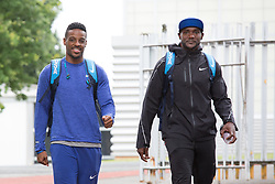© Licensed to London News Pictures. 28/7/2016. Birmingham, UK.  More than 150 athletes, officials and staff representing USA Track & Field (USATF) are staying in Birmingham at the end of July, ahead of the IAAF World Championships in London. Pictured, Justin Gatlin, right and Isiah Young walk out to the Birmingham track. Photo credit: Dave Warren/LNP