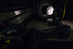 October 31, 2018 - U.S. - A Halloween view inside one of the darker recesses of ESA's technical heart. Shaded to resemble the blackness of deep space, the GNC Rendezvous, Approach and Landing Simulator, or GRALS, is seen being used to test vision-based navigation algorithms under development for the proposed Hera binary asteroid mission. A camera, mounted on a robot arm that moves along a 33-m long track, approaches a pair of 3D-printed asteroid models. Hera, Earth's first mission to a binary asteroid system, would use vision-based algorithms to map surface features on an automated basis to plot its position in space and plan its onward route. To simulate space, the chamber is kept dark for the testing, except for a single Sun-like light source. (Credit Image: ? NASA/ESA/ZUMA Wire/ZUMAPRESS.com)