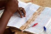 A teacher fills in the register at Pope John.s Catholic School in northern Ghana.