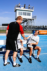 Bristol City Assistant Head Coach Dean Holden greets Derby County manager Phillip Cocu during the 2nd leg of the match after the previous day's game was abandoned at half time due to extreme weather - Rogan/JMP - 14/07/2019 - IMG Academy, Bradenton - Florida, USA - Bristol City v Derby County - Pre-Season Tour Day 3.