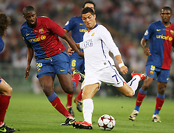 Manchester United's Cristiano Ronaldo (r) and FC Barcelona's Toure Yaya during the UEFA Champions League Final match in Roma.May 27 2009.