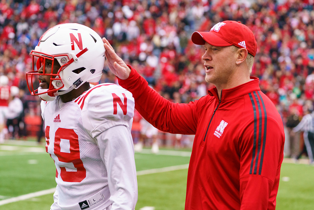 Scott Frost talks to Marquel Dismuke #19 during Nebraska's annual Spring Game at Memorial Stadium in Lincoln, Neb., on April 21, 2018. © Aaron Babcock
