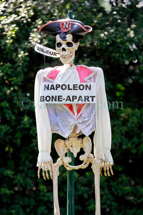 30 October 2015. New Orleans, Louisiana.<br /> The Skeleton Krewe mansion on St Charles Avenue at the corner of State Street draws crowds with its satirically spooky Halloween decorations. Napoleon Bonaparte is depicted as Napoleon Bone-apart.'<br /> Photo©; Charlie Varley/varleypix.com