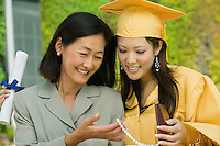 Mother and Daughter Admiring Gift at Graduation
