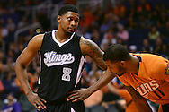 Nov 7, 2014; Phoenix, AZ, USA; Sacramento Kings forward Rudy Gay (8) talks with Phoenix Suns forward Markieff Morris (11) at US Airways Center. The Kings won 114-112 in double overtime. Mandatory Credit: Jennifer Stewart-USA TODAY Sports