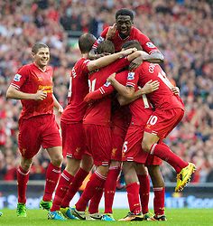 17.08.2013, Anfield, Liverpool, ENG, Premier League, FC Liverpool vs Stoke City, 1. Runde, im Bild Liverpool's Daniel Sturridge celebrates with team-mates after scoring the first goal against Stoke City during the Premiership match at Anfield during the English Premier League 1st round match between Liverpool FC and Stoke City FC at Anfield, Liverpool, Great Britain on 2013/08/17. EXPA Pictures © 2013, PhotoCredit: EXPA/ Propagandaphoto/ David Rawcliffe<br /> <br /> ***** ATTENTION - OUT OF ENG, GBR, UK *****