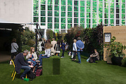 Shoppers enjoy the new John Lewis open air roof garden above their London Oxford Street branch, celebrating the retailer's 150th anniversary.