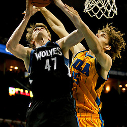 Dec 14, 2012; New Orleans, LA, USA; Minnesota Timberwolves small forward Andrei Kirilenko (47) shoots over New Orleans Hornets center Robin Lopez (15) during  the second half of a game at the New Orleans Arena. The Timberwolves defeated Hornets 113-102. Mandatory Credit: Derick E. Hingle-USA TODAY Sports