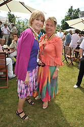 Left to right, LADY STEWART and LADY MOSS at a luncheon hosted by Cartier for their sponsorship of the Style et Luxe part of the Goodwood Festival of Speed at Goodwood House, West Sussex on 5th July 2009.