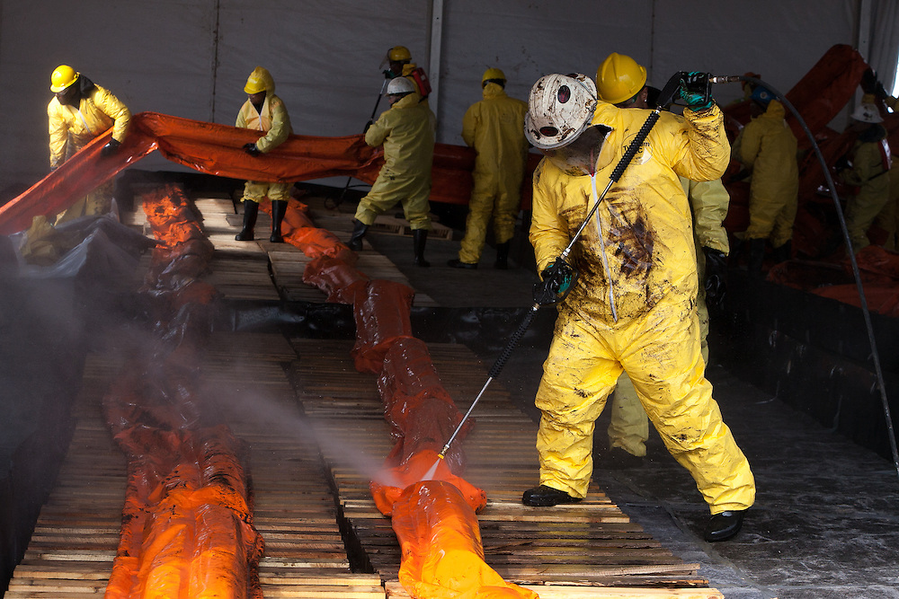 Relief crew cleaning oil covered booms.