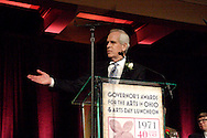 Stephen Freeze, CEO of Freund, Freeze & Arnold points out the rest of his table as he accepts the award for Business Support of the Arts on behalf of the FF&A law offices during the Governor's Awards for the Arts in Ohio & Arts Day Luncheon at the Athenaeum in downtown Columbus, Ohio, Wednesday, May 11, 2011.