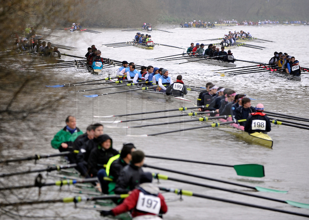 © Licensed to London News Pictures. 17/03/2012. London, UK. Crews jostle for staring positions. Crews participate in the rain today,  Saturday 17th March, in The Head of the River Race which is rowed annually in March from Mortlake to Putney on the River Thames in London.  Over 400 crews of eights take part, making it one of the highest participation events in London.. Photo credit : Stephen SImpson/LNP