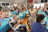 Barbecue hosted by Merrick Post #1282 of American Legion for veterans from New York State Nursing Home at Stony Brook NY, on August 13, 2011, in Merrick, New York, United States. Audience watching Irlsh Step Dancers (not seen). Photo © 2011 Ann Parry, All rights reserved. Ann-Parry.com