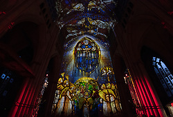 © Licensed to London News Pictures. 14/06/2018. York, UK. The Nave and West Window of York Minster is illuminated by the 'Northern Lights', a light projection and sound installation by projection artist Ross Ashton and sound artist Karen Monid. It is being held to raise funds for a new conservation campaign to protect the cathedral's medieval windows. Photo credit: Anna Gowthorpe/LNP