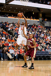 Virginia guard Monica Wright (22) shoots over Florida St. guard Courtney Ward (12).  The Virginia Cavaliers women's basketball team defeated the Florida State Seminoles 77-58 at the John Paul Jones Arena in Charlottesville, VA on February 10, 2008.