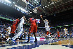 Kentucky guard Jamal Murray, center, drives to the basket in the first half. The University of Kentucky hosted Ole Miss, Saturday, Jan. 02, 2016 at Rupp Arena in Lexington.