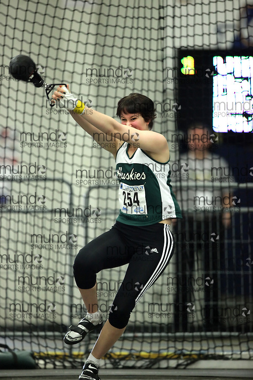 (Windsor, Ontario---11 March 2010) Kristen Mackie of University of Saskatchewan competes in the  competes in the weight throw at the 2010 Canadian Interuniversity Sport Track and Field Championships at the St. Denis Center. Photograph copyright Geoff Robins/Mundo Sport Images. www.mundosportimages.com