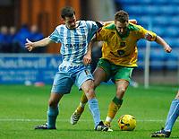 Photo: Daniel Hambury.<br />Coventry City v Norwich City. Coca Cola Championship.<br />26/11/2005.<br />Norwich's Darren Huckerby (R) battles with Coventry's Darren Huckerby