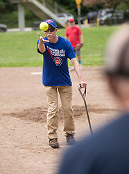 Former player Dick throws out the ceremonial first pitch as the Montclair softball league celebrates its 50th season, Saturday, April 22, 2017, at Montclair Park in Oakland, Calif. The pickup softball game, played every Saturday by a group of enthusiasts ranging in age from 20 to 75, started in 1968 in Berkeley and moved to Montclair about 25 years ago. (Photo by D. Ross Cameron)