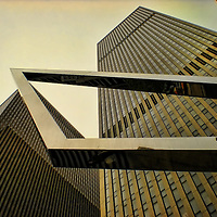Image of the towers of Rockefeller Center with modern metal sculpture in the foreground. Added vignette and textures.