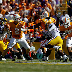 Oct 2, 2010; Baton Rouge, LA, USA; Tennessee Volunteers quarterback Matt Simms (2) is pressured by LSU Tigers linebacker Ryan Baker (22) during the first half at Tiger Stadium.  Mandatory Credit: Derick E. Hingle