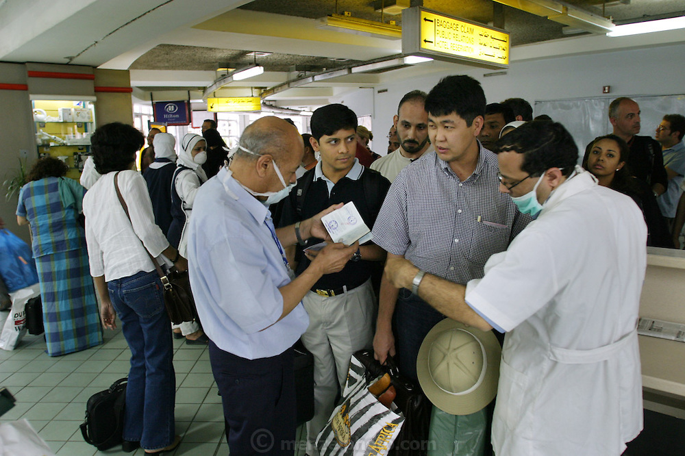 Health officials conducting a SARS inspection at the Cairo airport for passengers entering Egypt during the SARS epidemic of 2002-2003. (Severe Acute Respiratory Syndrome).