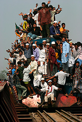 BANGLADESH TONGI 4FEB07 - Overcrowded trains ferry worshippers to and from Tongi Junction during the last day of the BiswaIjtema outside Tongi, a northern suburb of the capital city Dhaka. The annual Tablighi Jamaat Islamic movement congregation lasts three days and is attended by over two million Muslims, making it the second largest congregation after the Hajj to Mecca. Devotees from approximately 80 countries, including the host country, Bangladesh, attend the three-day Ijtema seeking divine blessings from Allah. The event focuses on prayers and meditation and does not allow political discussion. The local police estimated the number of attendees of the 2007 Ijtema to be 3 million...jre/Photo by Jiri Rezac..© Jiri Rezac 2007..Contact: +44 (0) 7050 110 417.Mobile:  +44 (0) 7801 337 683.Office:  +44 (0) 20 8968 9635..Email:   jiri@jirirezac.com.Web:    www.jirirezac.com..© All images Jiri Rezac 2007 - All rights reserved.