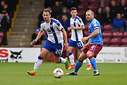 Chesterfield FC striker Kristian Dennis (20) and Scunthorpe United midfielder Stephen Dawson (8)  during the EFL Sky Bet League 1 match between Scunthorpe United and Chesterfield at Glanford Park, Scunthorpe, England on 17 April 2017. Photo by Ian Lyall.