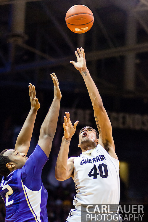February 9th, 2014:  Colorado Buffaloes sophomore forward Josh Scott (40) puts up a hook shot over Washington Huskies senior forward Perris Blackwell (2) in the second half of the NCAA Basketball game between the Washington Huskies and the University of Colorado Buffaloes at the Coors Events Center in Boulder, Colorado