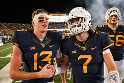 Nov 4, 2017; Morgantown, WV, USA; West Virginia Mountaineers wide receiver David Sills V (13) and West Virginia Mountaineers quarterback Will Grier (7) celebrate after beating the Iowa State Cyclones at Milan Puskar Stadium. Mandatory Credit: Ben Queen-USA TODAY Sports