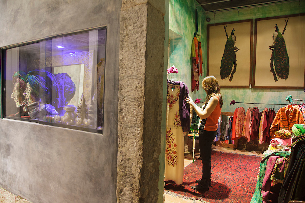 "A lady testing clothes at ""Lost In"", an India-inspired shop and restaurant."