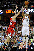 Apr 19, 2010; Cleveland, OH, USA; Cleveland Cavaliers forward Jamario Moon (15) shoots over Chicago Bulls guard Kirk Hinrich (12) during the first period in game two in the first round of the 2010 NBA playoffs at Quicken Loans Arena. Mandatory Credit: Jason Miller-US PRESSWIRE