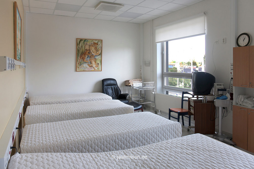 large patient room with row of  beds in delivery unit.
