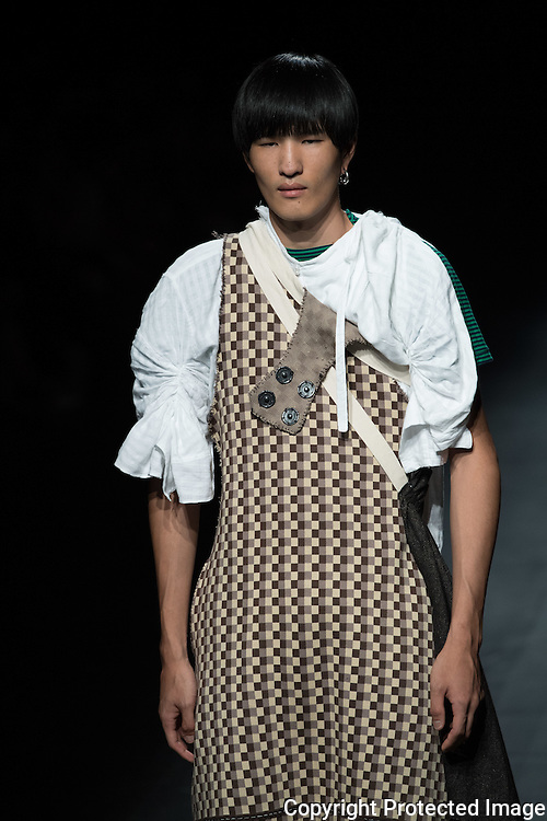 """OCTOBER 23: A model  presents the BAGASAO collection at the Amazon Fashion Week Tokyo's 2017 Spring/Summer during the Asian Fashion meets Tokyo show under way at Shibuya Hikarie in Tokyo on Oct. 23, 2016. and other locations through 23rd. Joseph Agustin S. Bagasao graduated from BS Psychology before finishing Fashion Design & Technology at the Fashion Institute of the Philippines. Having been awarded """"Designer of the Year"""" in 2011 by the school, he was sent to Paris on a fashion trip as a recognition for his talent. In the same year, he was selected as one of the Philippines """"Emerging Fashion Talent"""" awardees by Preview Magazine and in 2012 as """"Designers to Watch for"""" by Meg Magazine. In 2013, he was chosen as one of the top 10 finalists in the Style Awards of the Philippines. He continued to hone his craft by interning for Filipino designers and eventually became a designer for the high-end international retail brand Josie Natori until he founded his brand Bagasao in 2015. Nearly 50 fashion brands and companies will hold their shows at several locations through 23rd..23/10/2016-Tokyo, JAPAN"""