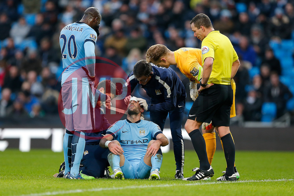 Pablo Zabaleta of Manchester City has his head bandaged after colliding with teammate Eliaquim Mangala who looks on - Photo mandatory by-line: Rogan Thomson/JMP - 07966 386802 - 28/12/2014 - SPORT - FOOTBALL - Manchester, England - Etihad Stadium - Manchester City v Burnley - Barclays Premier League.